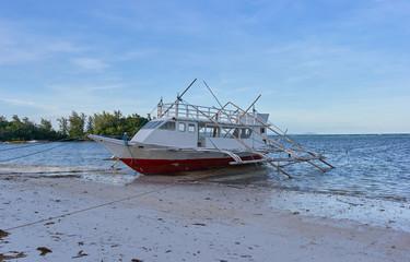 Bangka fishing boat on the coastline, Philippines