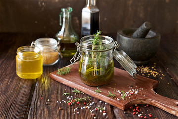 Vinaigrette dressing for salad. French cuisine. Olive oil, wine vinegar, honey, mustard and herbs ingredients