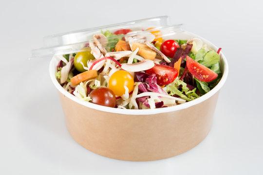 Fresh organic mixed green salad with pumpkin carton box