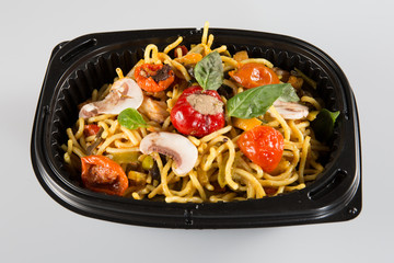 Noodles vegetables in take-out box togo