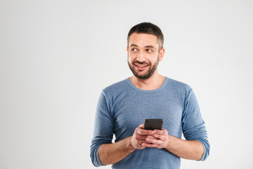 Cheerful man chatting by mobile phone.