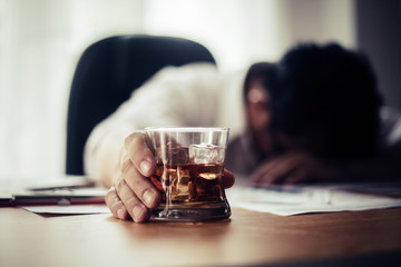 Foto auf Acrylglas Bar Businessman drinking from stress at workplace