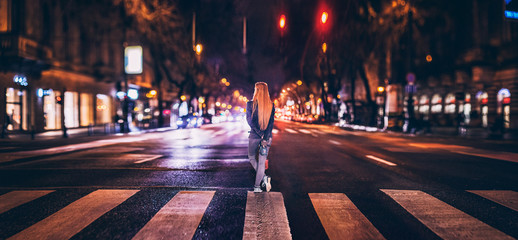 Red photographer girl middle in the night crossing Fotomurales