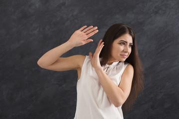 Unpleasant feeling, woman expressing disgust