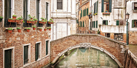 Wall Mural - A bridge over a small canal, Venice Italy