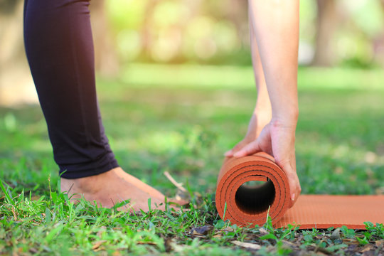 Close-up of woman keep yoga mat for meditating to relax in nature, Healthy lifestyle concept