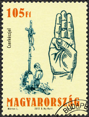 HUNGARY - 2012: shows the scout salute, centenary of the foundation of the Hungarian Scout Association