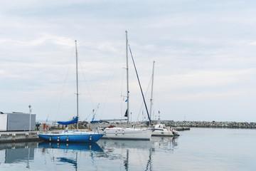 Three Motor Boats in Harbor