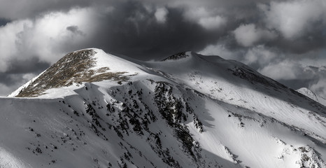 Dramatic winter storm clouds over Peak 4 at Breckenridge in the Rocky Mountains, Colorado