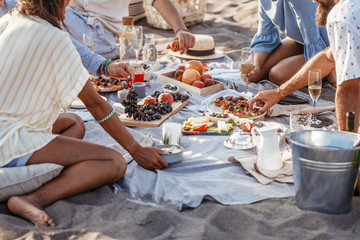 People Enjoying Food on Beach Picnic