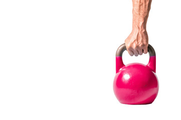 Strong muscular man hand with muscles holding purple heavy kettlebell partially isolated on white background