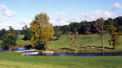 England, Cotswolds, Gloucestershire, peaceful Sherborne Valley autumn colour