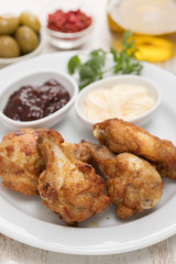 fried chicken with sauces on white plate