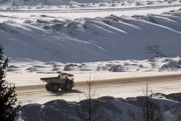Large dump truck in a surface mine in winter