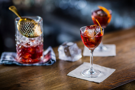 Manhattan cocktail drink decorated on bar counter in pub or restaurant.