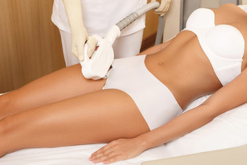 Woman during laser hair removal
