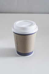 Disposable coffee cup on a neutral background