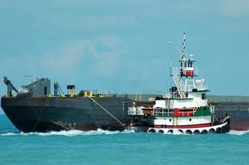 Tug boat towing a bard