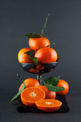 fresh ripe tangerines, rustic food photography on slate plate kitchen table can be used as background