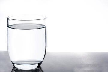 Glass with water on white background. Copyspace