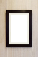 blank wooden photo frame on the wall