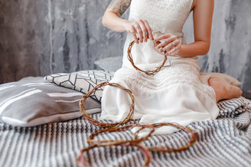 Workshop handmade in making decorative wreaths and dream catchers in rustic style.