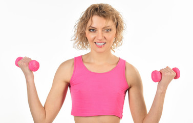 Sport. Fitness woman. Slim woman with dumbbells. Athletic girl flexing muscles with dumbbells. Fitness, sport, training, exercising and people concept - sporty woman exercising with pink dumbbells.