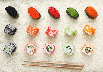 Top view on sushi rolls and gunkan on rice