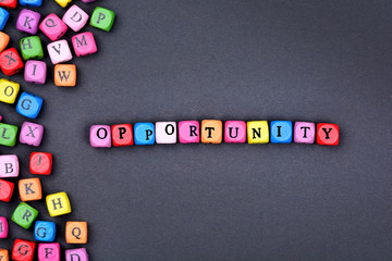 The word Opportunity on black background