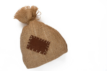Bag of burlap with a patch on white background