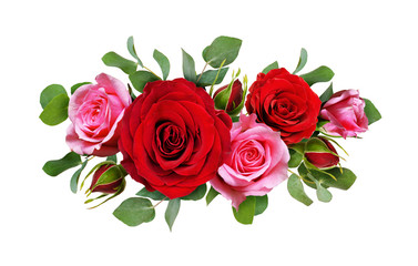 Red and pink rose flowers with eucalyptus leaves in a floral arrangement