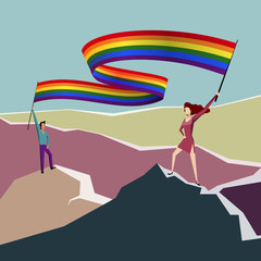 Man and woman with lgbt flag on a mountain