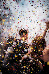 People celebrating with confetti