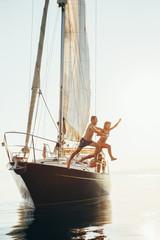 Family having fun on a sailboat.