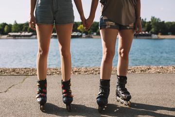 Friends Holding Hands in Roller Skates