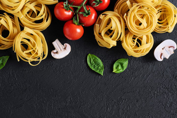 Ingredients for tagliatelle pasta on a dark background.