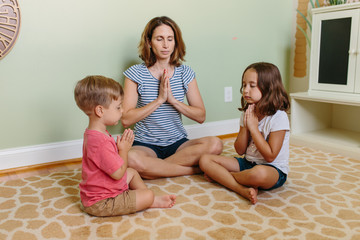Mother and her two children practicing mindfulness together