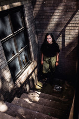 Teen girl waiting in an abandoned building