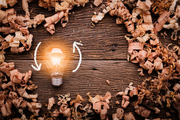 creativity ideas concept with light bulb with wood sawdust on wooden texture table with free copy space for your creativity ideas text