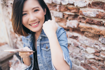 happiness asian beautiful shot hair woman hold smart phone and hand up for good news with happiness smile
