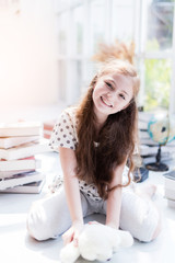 cute happiness kid girl is have fun and joyful moment with study book white room background
