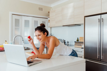 Brunette at Home Looking at Computer.