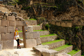 Tourist in the Ollantaytambo incan fortress ruins, remote, spectacular the Inca ruins near Cuzco. Cultivated terrace fields on the steep sides of a mountain, Peru, South America