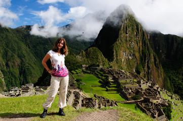 Tourist in the Machu Picchu ruins, remote, spectacular the Inca ruins near Cuzco, Peru, South America