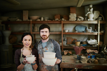 Potters family posing in workshop