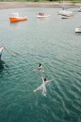 two girl swimming in the sea