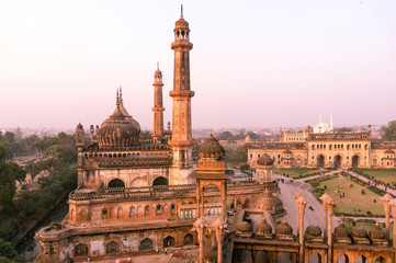 domed roof and towers of Asfi mosque shot at sunset from the rooftop of bara imambara in lucknow uttar pradesh india. This marvel of mughal architecture is a famous tourist destination