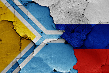 flag of Tuva and Russia painted on cracked wall