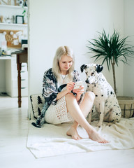 Woman with dog using smartphone