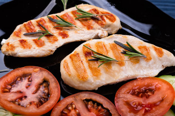 Top view of grilled chicken steaks with vegetables